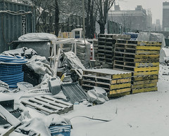 """""""Winter Season 2016-2017 In NYC"""" (Construction Site LES With Storage Area During Snow Storm) (nrhodesphotos(the_eye_of_the_moment)) Tags: dsc0046872 """"theeyeofthemoment21gmailcom"""" """"wwwflickrcomphotostheeyeofthemoment"""" winterseason20162017innyc winter season manhattan nyc reflections shadows snowy snow yard wood metal glass scraps platforms planks coils wall fence outdoor"""