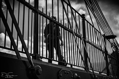bridge walker (Daz Smith) Tags: dazsmith fujixt10 fuji xt10 andwhite bath city streetphotography people candid canon portrait citylife thecity urban streets uk monochrome blancoynegro blackandwhite mono ma male bridge struts bars verticals lines silhouette clouds sky