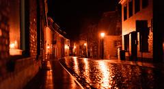 Reflections (Ir3nicus) Tags: nikond750 dslr fullframe germany deutschland niederrhein sonsbeck nordrheinwestfalen golden lights reflections street cobblestone streetlamp lowlight night houses pavement outdoor