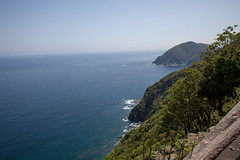 On a Cliff (George Alexander Ishida Newman) Tags: ocean road blue trees sea sky white mountain mountains beach up japan clouds walking landscape photography bay town photo high nice sand rocks surf day view top cliffs foliage skys oita kyushu