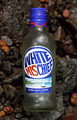 White Mischief (cowyeow) Tags: travel india white house sign trash forest logo asian design weird bottle garbage funny asia drink indian icon odd pollution packaging booze vodka thumb maharashtra thumbsup mischief pure forestfloor ultra funnysign hillstation softdrink westernghats ghats sahyadri amboli funnyindia southmaharashtra