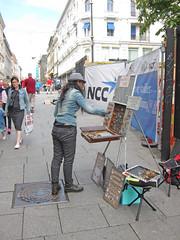 Preparing the shop (mittalbum) Tags: summer hat oslo female artist jewelry seller karljohan pedestrianarea canonpowershots90