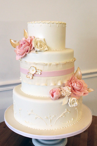 White and Ivory Wedding Cake With Piping and Pink Flowers