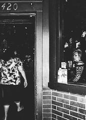 Nashville, Tennessee (G. L. Brown) Tags: blackandwhite bw woman window monochrome bar nashville tennessee streetphotography nightclub storefront signage grainy nashvillestreetphotography