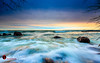 Stone Rush (andrewslaterphoto) Tags: boulder boulderpoint clouds greatlakes lakemichigan landscape longexposure mke milwaukee rush sunrise waves canon 5dmarkiii discoverwisconsin travelwisconsin mkemycity lakefront