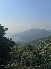 Wide view from the Lantau Peak trail in Hong Kong. (okaystephanie) Tags: hong kong travel culture china history urban spaces cityscapes ferris wheel skyscrapers street art asia modern chinese architecture nature buddha tian tan statues sky lifts trams signs signage