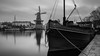 Safe Harbour (McQuaide Photography) Tags: haarlem noordholland northholland netherlands nederland holland dutch europe sony a7rii ilce7rm2 alpha mirrorless 1635mm sonyzeiss zeiss variotessar fullframe mcquaidephotography lightroom adobe photoshop tripod manfrotto light licht water reflection stad city urban waterside lowlight architecture outdoor outside waterfront building longexposure blackandwhite blackwhite bw mono monochrome nd neutraldensity bwfilters 6stop 169 widescreen panoramic winter river spaarne rivier boat boot moored harbour molen windmill deadriaan riverside calm stil peaceful harbor wideangle wideanglelens groothoek