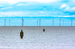 Another Place turbines (Rockman of Zymurgy) Tags: landscape gormley anotherplace crosby liverpool turbine wind windmill sea seascape statue sculpture tidal sky blue