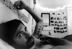 (SamBHart) Tags: 35mmfilm nikonfm2 analogphotography analog bw blackandwhite monochrome photoprinting filmprocessing 24mmlens nikkor wideangle superwide portland oregon personal friends tattoo bedroom intimate boy cute cozy