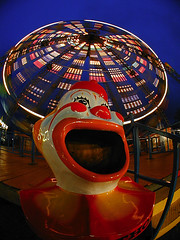 Clown and Carousel (JB Photo) Tags: usa ny motion night mouth unitedstates clown carousel fair laugh statenisland merrygoround circular