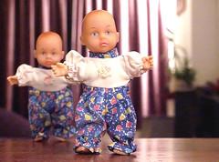 Dolls dressed alike...
