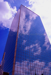Skyscraper Downtown... during the prettier part of our day :) (joschmoblo) Tags: sky copyright reflection building clouds skyscraper d50 nikon downtown kentucky louisville cbd 1855 allrightsreserved 2007 morethanderby joschmoblo christinagnadinger