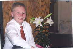 Zach by the Easter Lily at church - by bulldog1