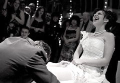 Wedding: Removing the garter (Ryan Brenizer) Tags: nyc newyorkcity wedding newyork brooklyn pretty fuji emotion candid crowd 2006 finepixs2pro sigma30mmf14dc noflash april unposed brooklynbotanicalgardens sigma30mmf14exdchsm