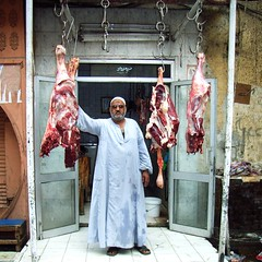 Muslimbutcher (Ginas Pics) Tags: people food woman man sunglasses flesh se market traditional working egypt streetphotography meat butcher tradition trade rawmeat hadith travelphotography ginaspics gettypic  egyptpics allaboutegypt muslimbutcher  schahada  hadithen streetphotographycandidstreetportrait mygettys reginasiebrecht foodondisplaylocalfood