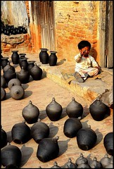 The potter child (A VersAerien) Tags: nepal nikon asia child potter 2550fav pottery asie nepalese d200 enfant artisan bhaktapur nepali népal artisanat potier poteries fivestarsgallery