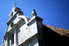 Sta Rosa de Lima (Farl) Tags: travel windows roof white color heritage church colors stone island islands catholic shadows cross faith philippines religion north chapel thatch portal simbahan lime tradition portals batanes cogon chavayan sabtang starosadelima