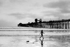 Girl, water, pier (scragz) Tags: california people beach girl canon lenstagged sandiego oceanside 10d canon28105f3545