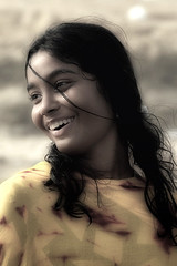 Serene Joy (Fayyaz Ahmed) Tags: portrait color beach topf25 girl monochrome beautiful beauty smile yellow hair happy topf50 warm pretty candid joy teen serene desaturated theface hawksbay nikonstunninggallery portraitclassicshalloffame chercherlafemme