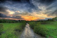 etobicoke creek at sunset (n+s) Tags: sunset sky toronto ontario canada green 20d topf25 water topv111 clouds canon river ilovenature topf50 topv555 topv333 topv1111 topv222 urbannature topv777 1022mm hdr efs1022mm interestingness58 i500 scienceduck nicesmooth holymolyisthatabeaver flickrplatinum