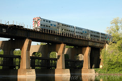 Metra Crossing the Fox River (Jim Frazier) Tags: park railroad bridge light brown building industry up station metal train sunrise river landscape concrete island dawn illinois scenery shiny commerce angle geneva diesel v100 piers may tracks structures bridges machine beautifullight engineering rail railway trains 2006 heavymetal structure equipment business machinery engines depot unionpacific f3 machines foxriver kane metra f5 q3 railroads chicagoland v200 passengertrain islandpark interestinglight v500 threequarter v1000 foxriverarea miscmay2006 threequarterangle genevametrastation jimubs genblog jimfraziercom