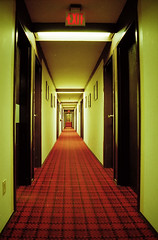 Eagle Plains hotel (-Antoine-) Tags: 2002 canada film canon carpet hotel hall topf50 500v20f eagle topc75 tapis tunnel symmetry creepy spooky yukon exit plains plaid overlook shining couloir klondike carpeting eagleplains htel symtrie eoselan7 antoinerouleau