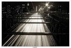 The Never ending Stream (Arnold Pouteau's) Tags: nyc longexposure bridge bw newyork brooklyn night downtown manhattan newyorcity