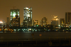 The city glows, the city grows (Anindo Ghosh) Tags: nightphotography bridge india beautiful skyline night twilight construction lowlight nightlights nightshot availablelight indian citylights maharashtra mumbai top20night cityatnight bandra worli nightskyline anindo lowlightphotography availablelightphotography anindoghosh mahimbay worlisealinkproject