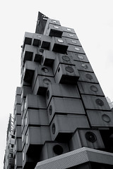 Nakagin Capsule Tower revisited (Lil [Kristen Elsby]) Tags: windows blackandwhite bw japan topv2222 architecture concrete tokyo office asia apartment modernism capsule modular pollution porthole  stacked modernist shimbashi nakagin kishokurokawa shinbashi eastasia selfcontained kurokawa   nakagincapsuletower