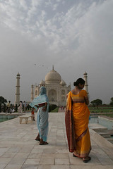 Woman in Saffron Saree at the Taj, India (Captain Suresh Sharma) Tags: travel ladies sky people sculpture woman india white holiday inspiration reflection building tower art heritage tourism monument water beauty grave birds architecture lady clouds river spectacular wonder landscape spiral fun outside religious boat wooden site kid women asia tour exterior symbol 17thcentury indian muslim islam famous small religion tomb towers young culture taj mahal agra social landmark icon tourist carving safety unesco mausoleum pollution memory dome burial destination historical marble pillars hindu hinduism carvings banks attraction sculpted sevenwonders oldtimes shahjahan mughal moghul minarette mumtaz yamuna pavingslabs famed mumtaj mausuleum