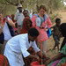 Orla O'Neill, Emerg. Nutritionist and Segolene De-BECO, Head of Office, ECHO Ethiopia observing a Mobile Health and Nutrition extension worker scaling a child