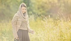 Sun filled field (Wojtek Piatek) Tags: ireland woman sun girl field grass walking golden haze hours zeiss135 sonya99