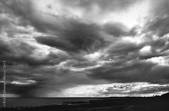 The Isle of Wight (rhfo2o - rick hathaway photography) Tags: sunset sea sky blackandwhite bw beach rain clouds mono seaside westsussex isleofwight groyne iphone rustington iphone4s rhfo2o