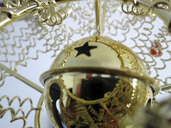 Bell In The Center. (dccradio) Tags: lumberton nc northcarolina robesoncounty christmas holiday decorations ornaments macro christmasornament bell jinglebell star gold goldcolored christmasstar reflection camerareflection