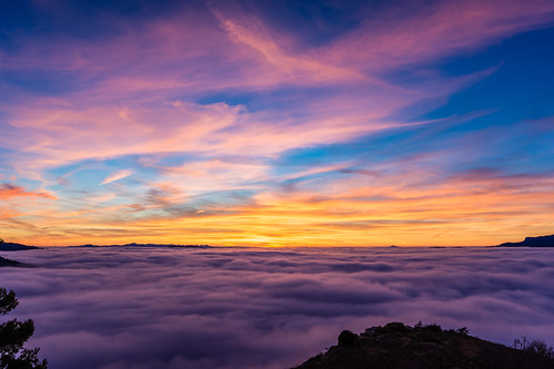 Sunset above the clouds.
