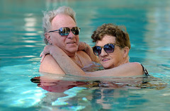 Sweethearts in the Pool (Poocher7) Tags: love romantic longtimelove sweethearts swimming pool sunglasses resort smiles affectionate seniors commitment fun happy joy momanddad water together vacation portrait people couple longtimemarried hugging usa florida southwestflorida marcoisland truelove sweet