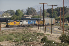 Westbound Auto dropping down Beaumont hill, CA (Travis Berryman) Tags: unionpacific beaumonthill uprr upyumasub desertrailroading