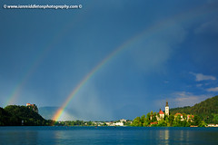 Double rainbow over Lake Bled (Ian Middleton: Photography) Tags: travel summer vacation mist lake holiday storm mountains reflection building green tower castle history tourism church water beautiful architecture clouds religious island rainbow scenery europe european bell famous scenic eu tourist architectural historic christian slovenia alpine touristy stunning bled former christianity popular yugoslavia attraction shimmering eec slovenian slovene gorenjska slavic