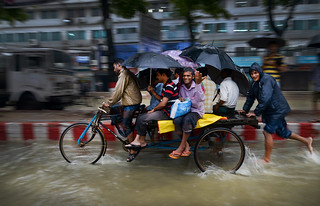 People use Rickshaw van for transport during heavy monsoon rains flood in Chittagong.