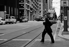 A Cold Blast Of Wind To The Face (burnt dirt) Tags: houston texas downtown town city mainstreet street streetphotography building wall people person girl woman bw cold coldweather metro train subway jacket face walk walking asian
