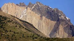 Soaring Precipitous Rock Faces of Peineta, The Comb  Torres Del Paine National Park Chile South America (eriagn) Tags: southamerica chile puertonatales torresdelpainenationalpark torresdelpaine towers peaks mountains spectacular landforms landformations rockformations snow glacier glacial ice precipitous mountain jagged cold imposing wether erosion reign ngairehart serranoglacier trekking hiking recreational travel photography landscape cloud wind gale mountainpeak hill mountainside mountainridge ridge towering steep challenging blue canon eos parquenacionaltorresdelpaine soaring rockfaces mountaineering recreation habitat environment geology painemassif cordilleradelpaine granite sedimentary magma thecomb peineta panorama nature greatworldlandscapes