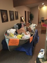 boat load of food pantry items given by:  FLC congregation, Spaghetti Supper event and Fur, Fin & Feathers event