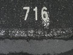 716 (Eva the Weaver) Tags: 716 number parking asphalt ground