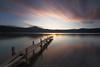 First lights... (DABMARCO www.marcodabbruzzi.com) Tags: sunrise alba lago lake pontile pier clouds