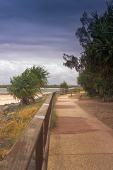 Path at the Sunshine Coast (k009034) Tags: 500px wind australia caloundra copy space pacific queensland tranquil scene beach bench bush clouds nature no people ocean oceania pandanus path rail rocks sea sky sunshine coast travel destinations teamcanon