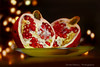 share the moment... (dimitra_milaiou) Tags: nature bokeh red pomegranate life love live still black lights night dark happy happiness greece greek nikon d 7100 d7100 milaiou dimitra festive green xmas world planet earth peace share cut card christmas europe 70210mm f4 ngc eat kitchen fruit
