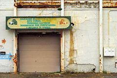 Indy#15613_Copy (Single-Tooth Productions) Tags: garage garagedoor abandoned abandonedgarage decay decaying crumbling neglect bleak architecturaldecay architecturalcomposition composition shapes lines colorblocks 2d flat architecture doorway entryway canlight fadingcanlight rust rusting text typography bluearrow scatherwoodave indianapolis indiana urban city building buildingdecay buildingcomposition urbandecay 50mm nikkor nikkor50mm nikond200 nikon