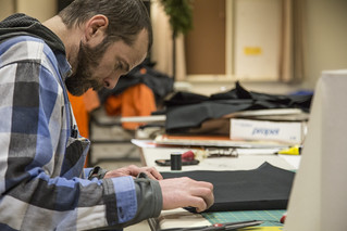 Mike Benedetti Sews Black Hoods for Guantánamo Detainee Costumes in Preparation for an Anti-Torture Demonstration