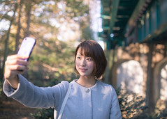 Young woman talking selfie picture with smart phone (Apricot Cafe) Tags: img12812 20s asianethnicity japan japaneseethnicity sigma35mmf14dghsm tokyo afternoon charming cheerful copyspace enjoying horizontal oneperson onlywomen outdoors park people selectivefocus selfie smartphone smiling standing takingpicrures toothysmile tranquility waistup walking winter woman youngadult musashinoshi tōkyōto jp