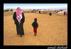 LIKE FATHER LIKE SON (amal shehab) Tags: amalshehab bekaa lebanon father son bedouin bedouins land pebbles walking walk tent cold